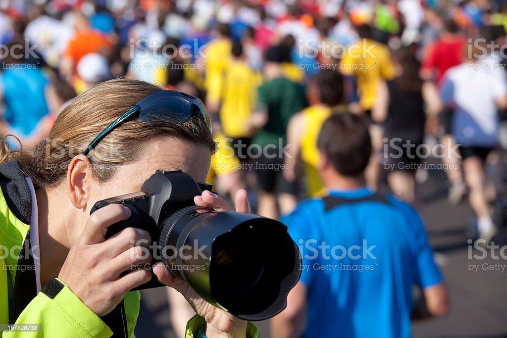 taking pictures at marathon stock photo