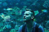 Young man in aquarium