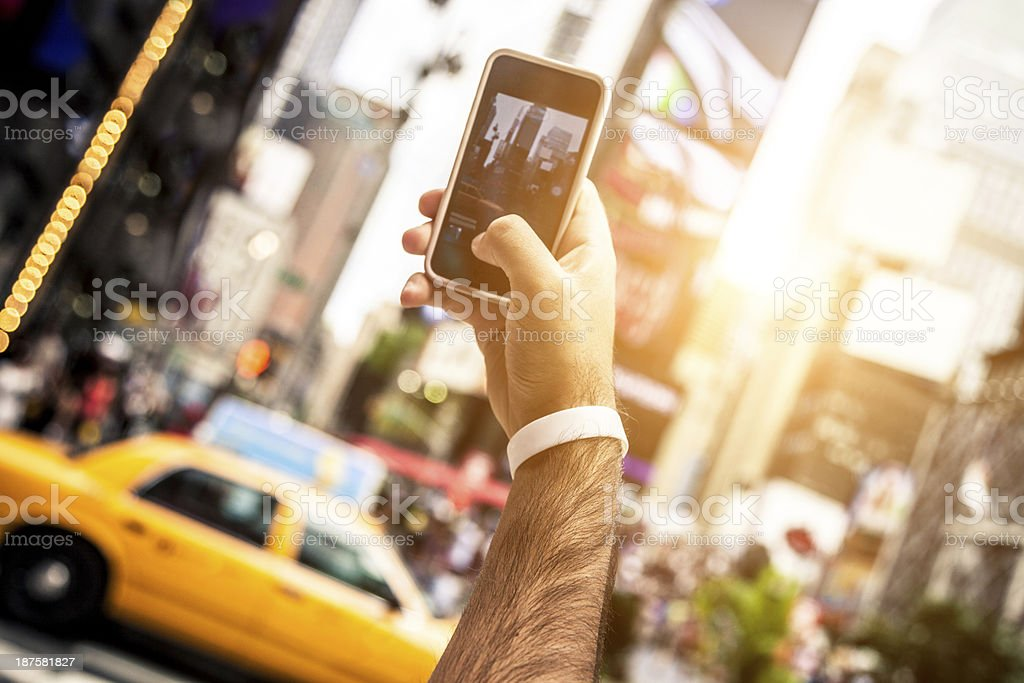 Taking pictures in Times Square royalty-free stock photo