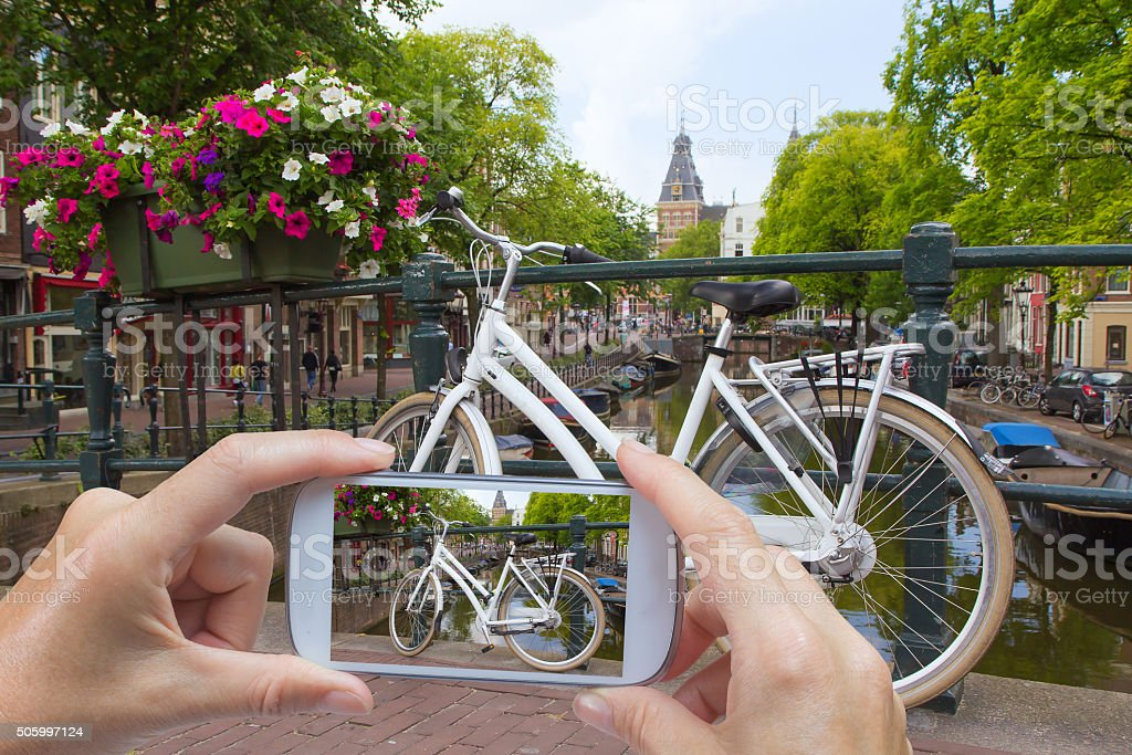 Taking pictures of a bicycle in Amsterdam (Netherlands) stock photo