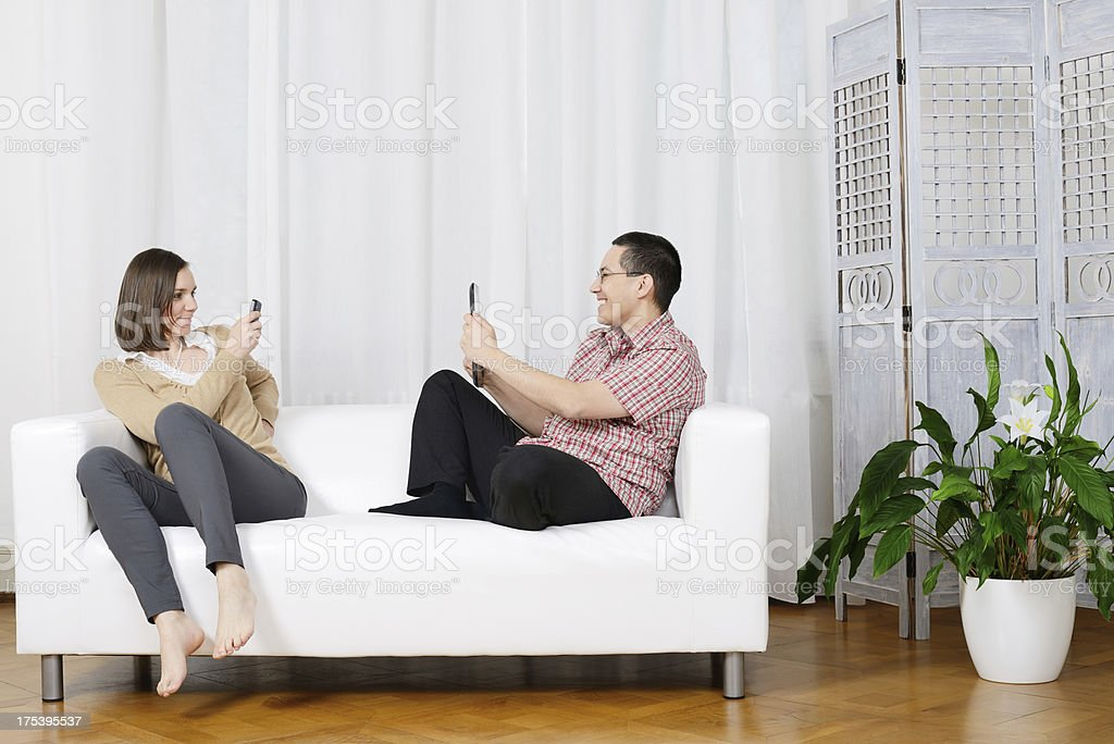 Taking Pictures with Handy and Tablet PC by Couple, Germany