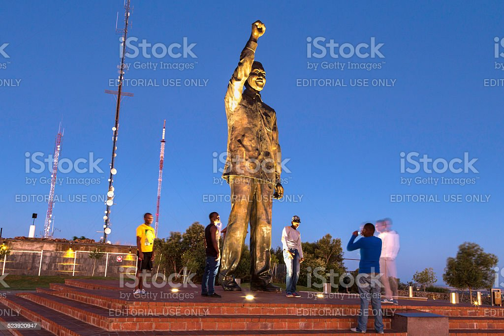 Taking pictures with Nelson Mandela statue in Bloemfontein stock photo