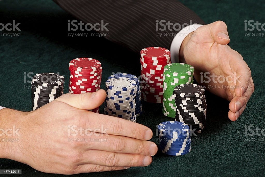 Taking piles of chips royalty-free stock photo
