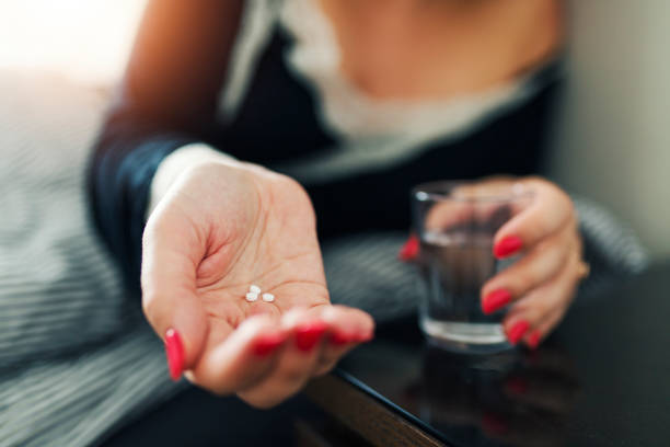taking pills - sleeping pill stock photos and pictures