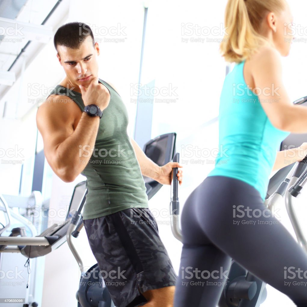 Taking rude looks in a gym. stock photo