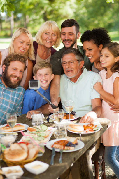 taking selfie at a family picnic - reunion stock photos and pictures