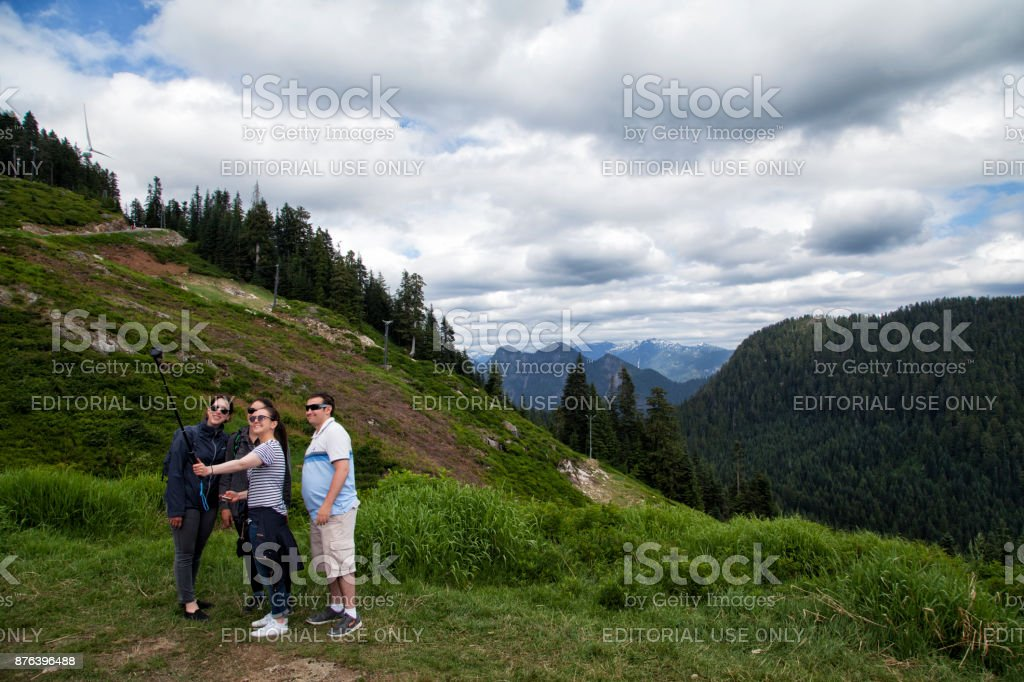 Taking Selfie at top of Grouse Mountain, Vancouver,Canada stock photo