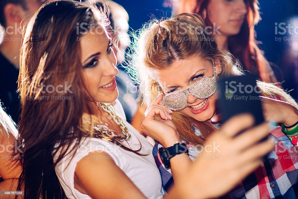 Taking selfie in the club stock photo
