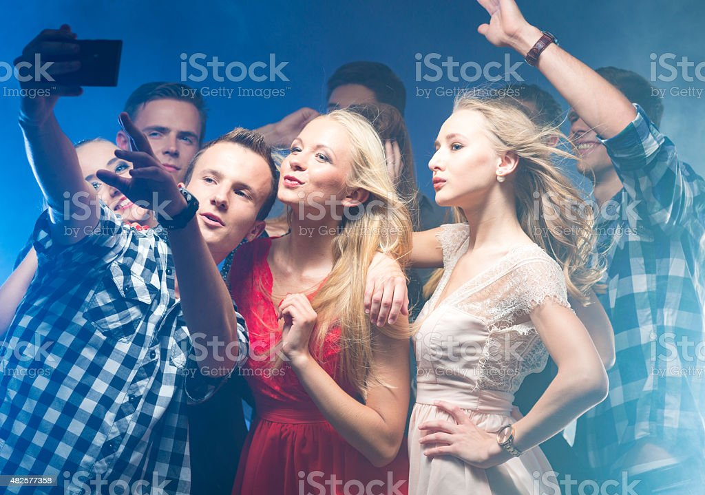 Taking selfie on party with friends stock photo