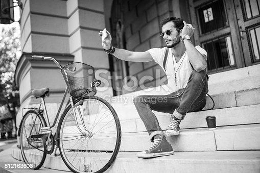 812812808istockphoto Taking selfie on steps 812163606