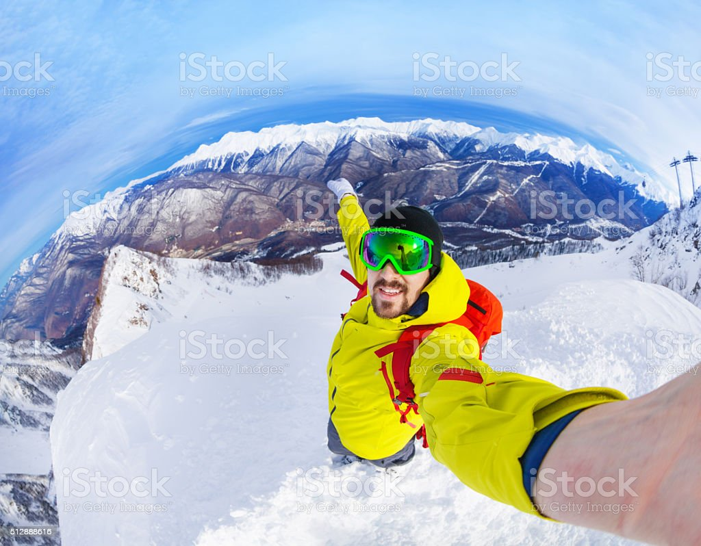 Taking selfie standing on top of the mountain stock photo