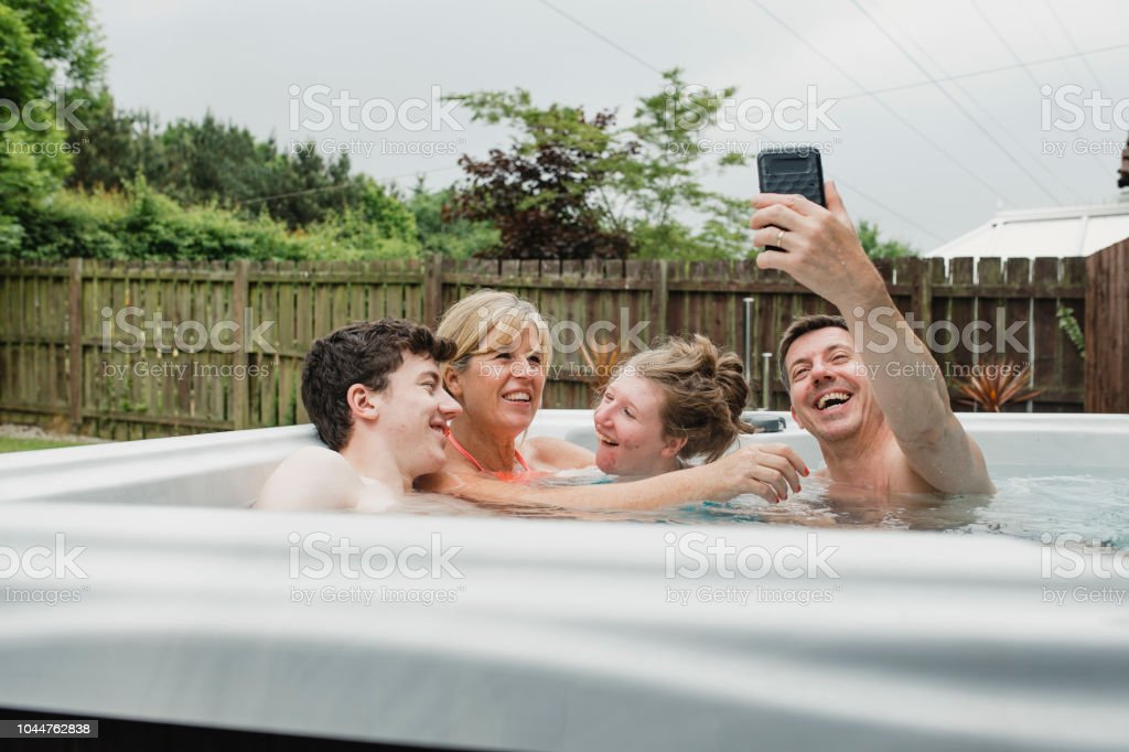 Taking Selfies in the Hydrotherapy Hot Tub stock photo