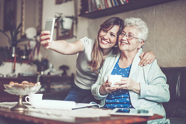 taking selfies - granddaughter and grandmother stock photos and pictures