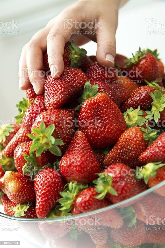 Taking strawberries royalty-free stock photo