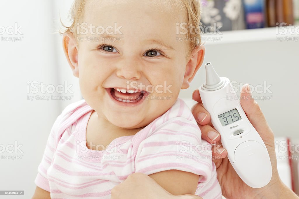 Taking temperature of an baby patient stock photo