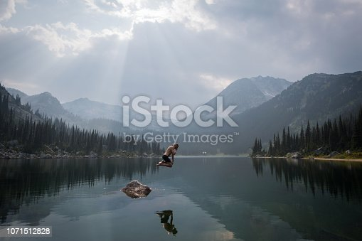 Jumping into a lake in the mountains