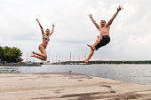 istock taking the plunge: young adults jump into Wannsee lake 1170462313