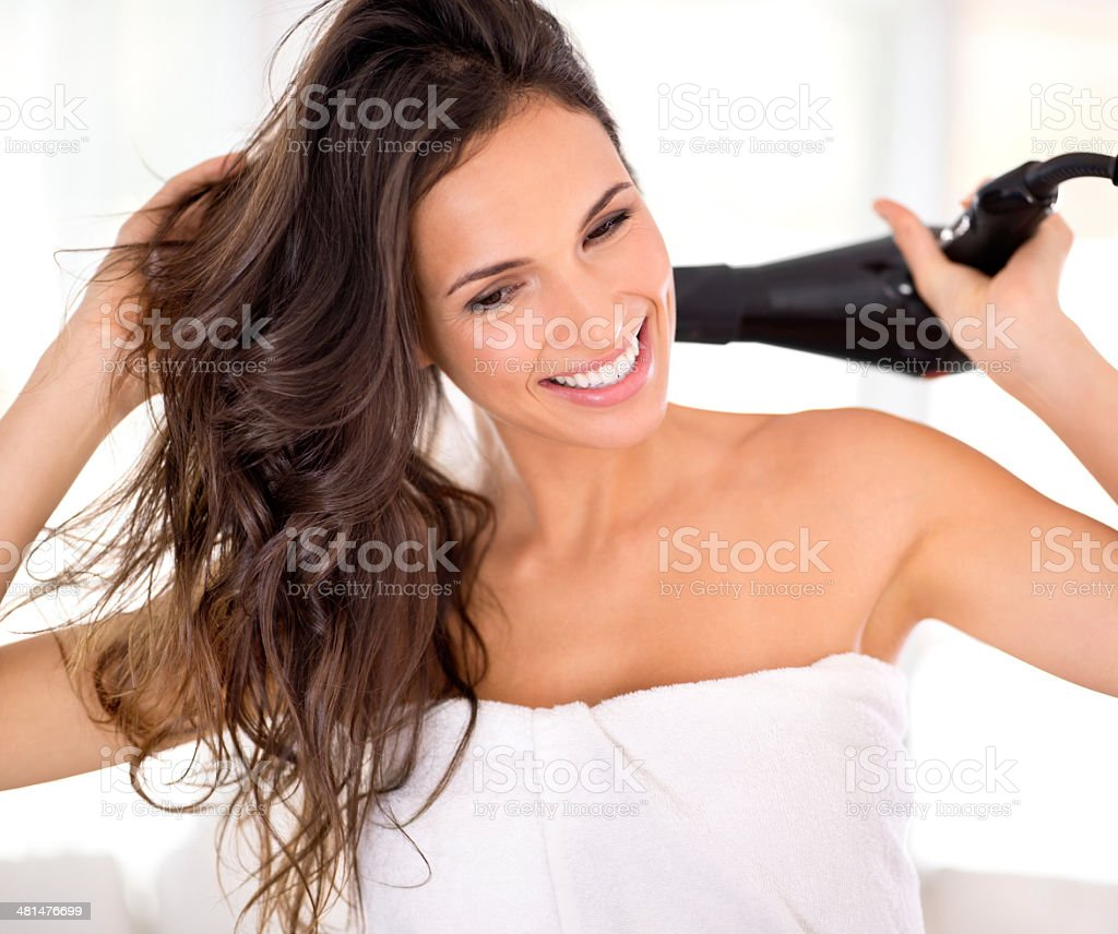Taking the time to care for her hair properly stock photo