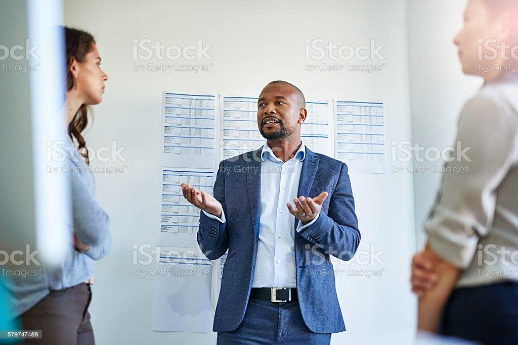 Taking the time to explain stock photo