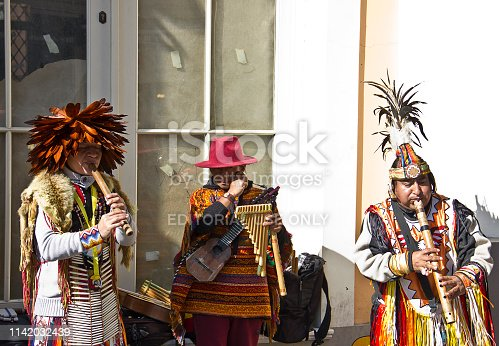 Istanbul, Turkey, February 17, 2019: Native American musicians in istiklal street, istanbul-turkey. Native American musicians playing their traditional music with particular handmade instruments. lots of people listening their ethnic music. they are earning some money on the street. Taksim is the region preferred by tourists at the same time. There are istiklal Avenue down the square that known in English as Independence Avenue, the most famous shopping street in the country sees as many as three million pedestrians on a busy weekend day.