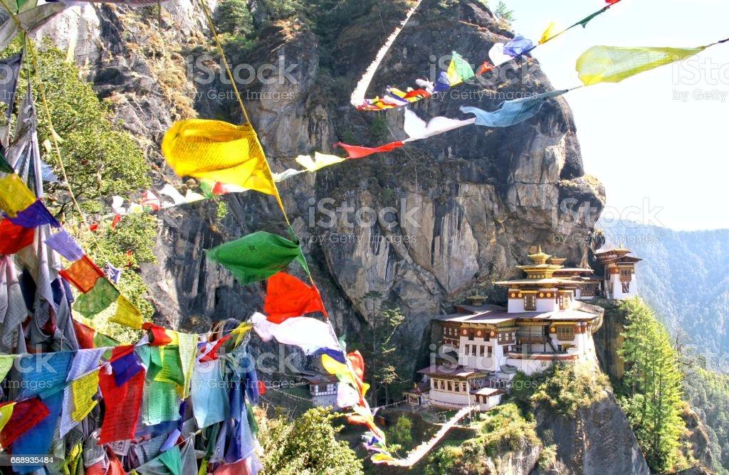 Taktshang Goemba or Tiger's nest monastery with colorful Tibetan prayer flags, Paro, Bhutan. stock photo