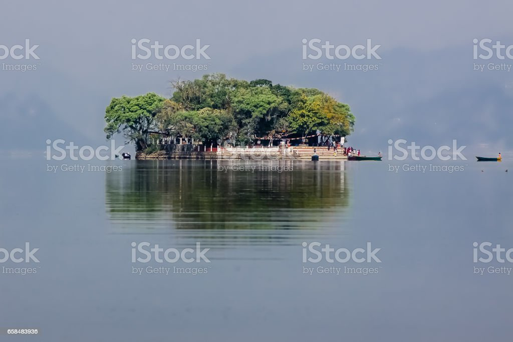 Tal Barahi Temple island in hazy Lake Phewa with reflections, Pokhara stock photo