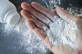 Talcum powder on hands