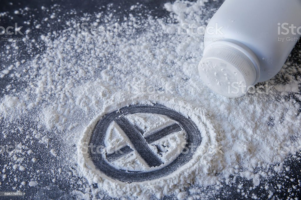 Talcum powder with cross sign on black background foto royalty-free