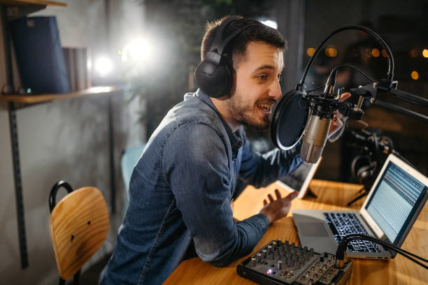 Talent for entertainment shows Photo of young man recording a podcast in a studio radio dj stock pictures, royalty-free photos & images