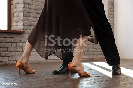 istock Talented aging couple waltzing in the ballroom 656933250