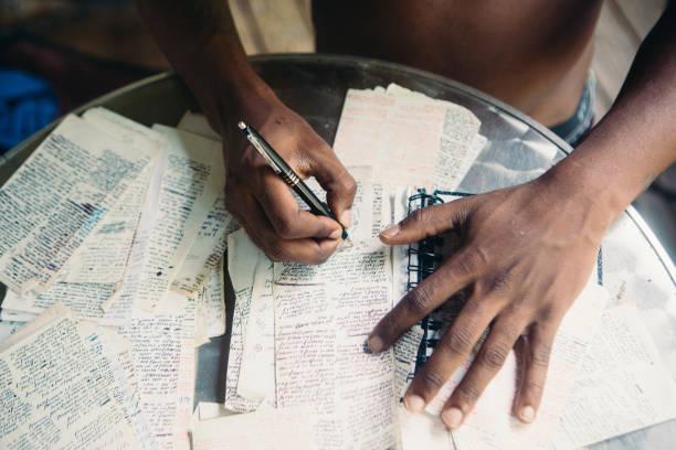 Talented Black Man Writing stock photo