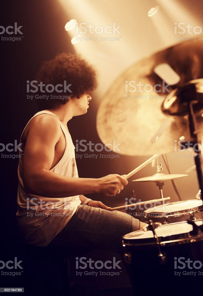 He plays to the beat of his own drum stock photo