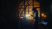 Young artist woman sculpturing using welding machine. Girl power concept