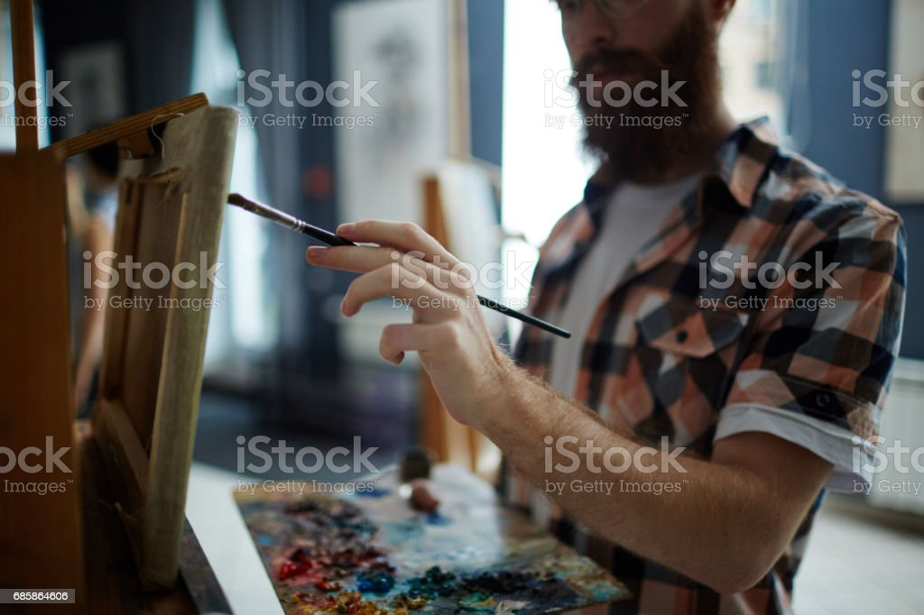Talented Modern Artist Painting Picture in Studio stock photo
