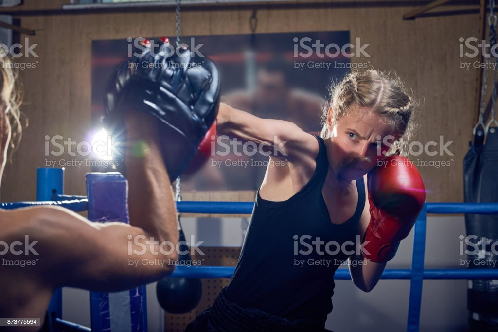 Talented Sportswoman in Boxing Ring stock photo