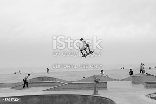 Venice Beach, California, USA - March 11, 2015: Sixteen-year-old Isaiah from Compton displays his skills on an overcast day at the Venice Beach Skate Park in Venice Beach, California.