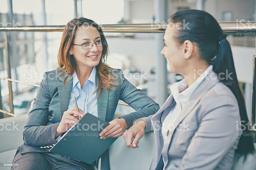 Talk of businesswomen stock photo