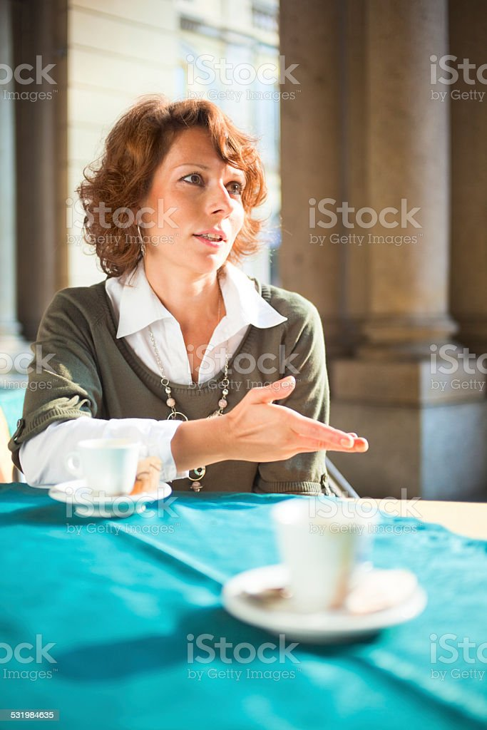Talk over espresso stock photo