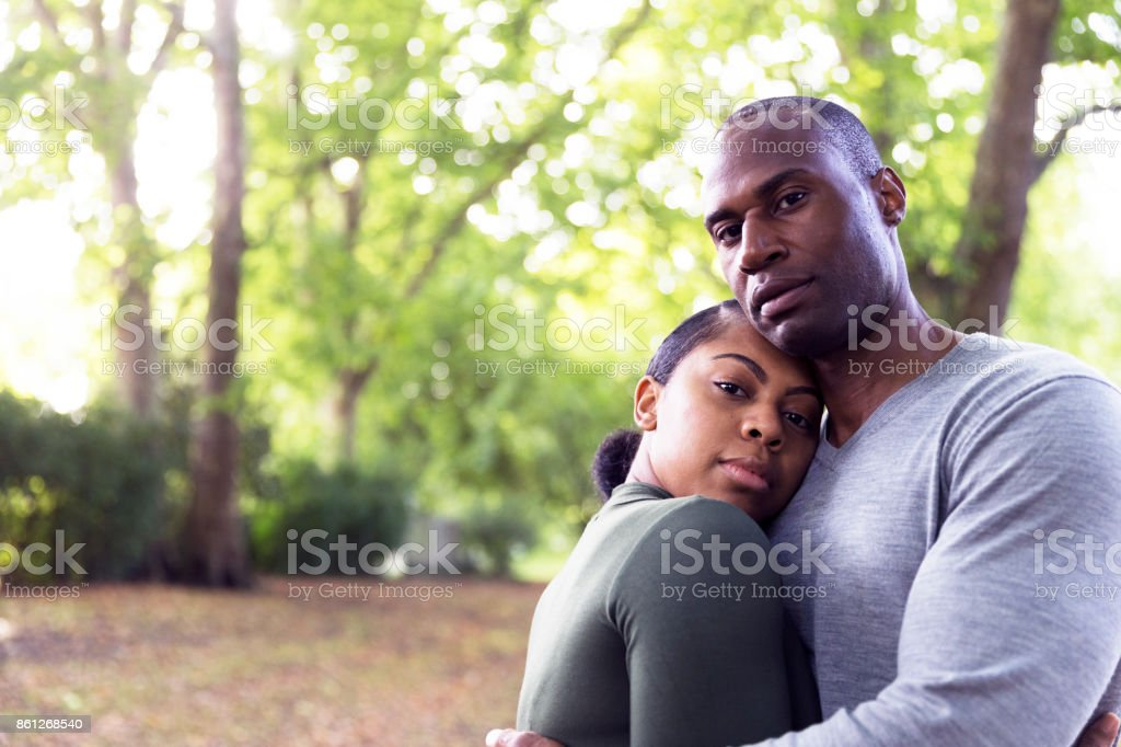Talk to me while speaking quietly together stock photo