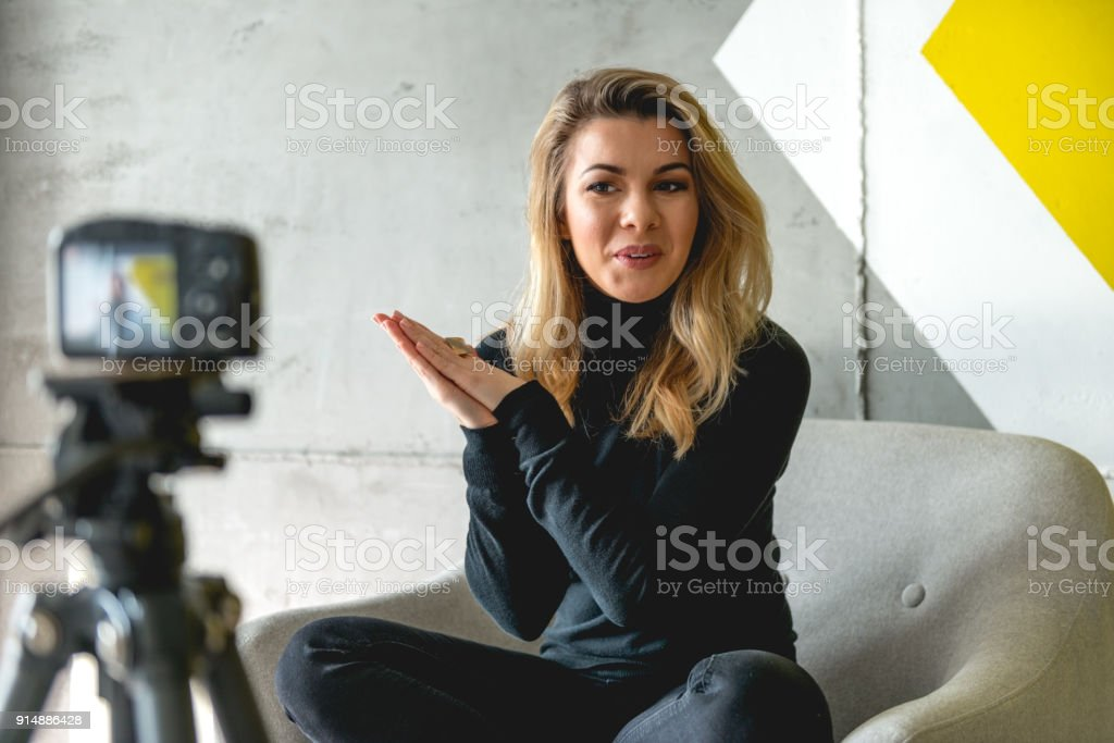 Talk to the audience via the camera stock photo