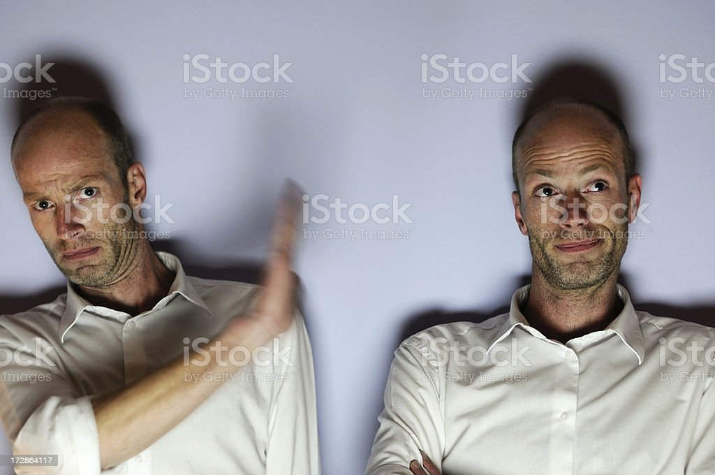 talk to the hand, twins twins having a conflict... Activity Stock Photo