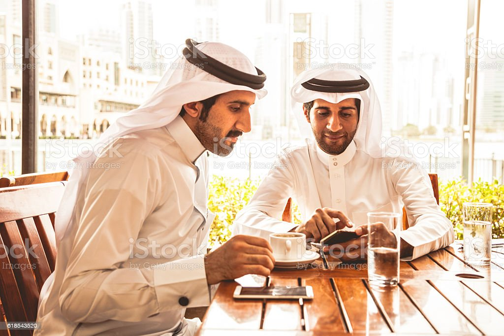 Talking about business at a cafe in Dubai stock photo