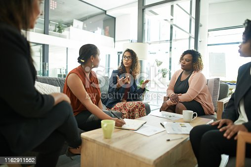 Shot of a group of businesswomen having a meeting in a modern office
