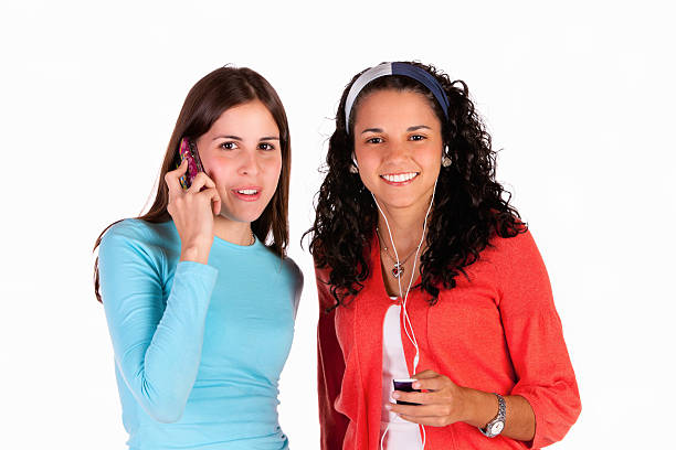 Talking and listening to mp3 music stock photo