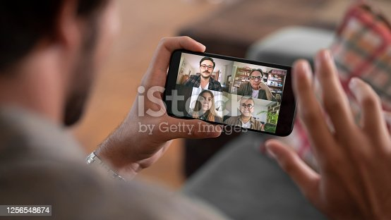 istock Talking and working on mobile phone 1256548674