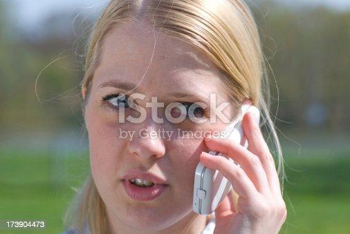 862201618 istock photo talking at phone 173904473