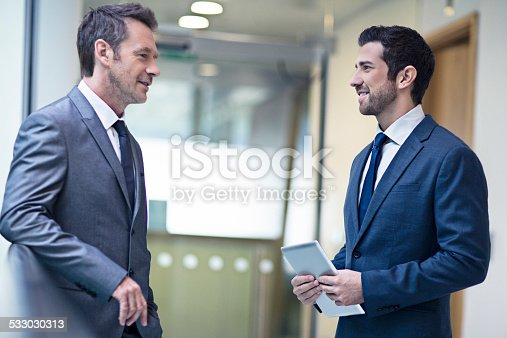 Two business men talking about work.