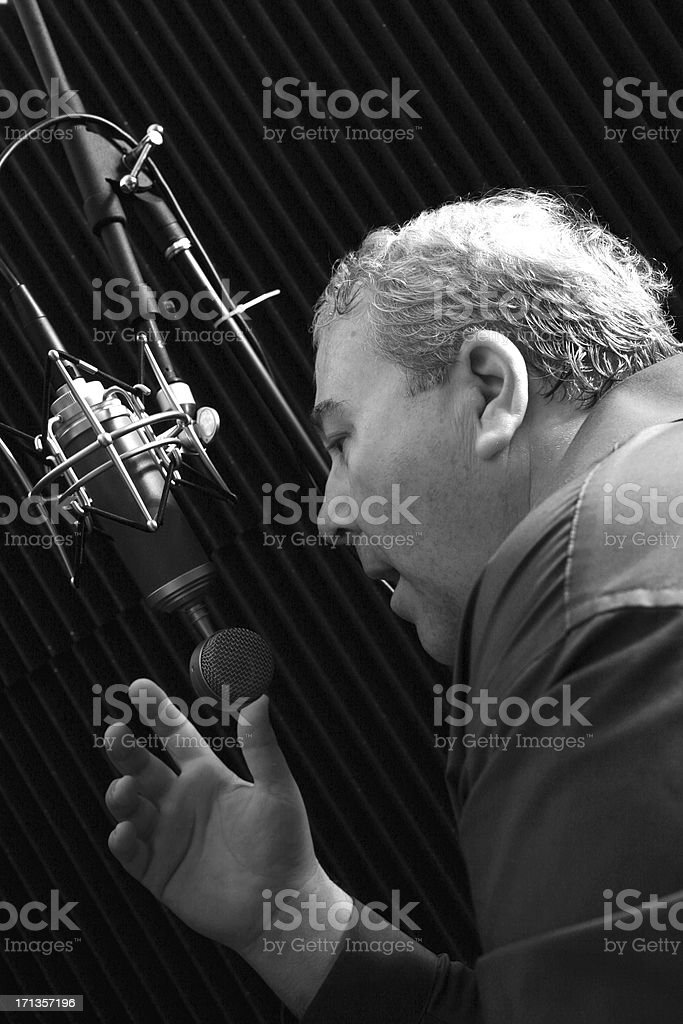 Talking in a Studio Microphone stock photo