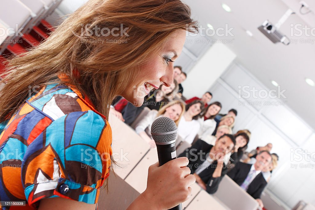 Talking in front of the audience stock photo