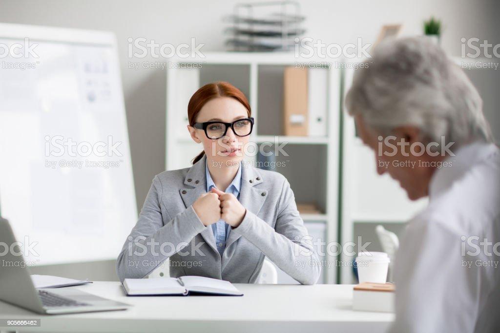 Talking to boss stock photo